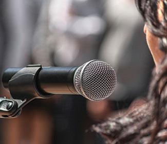 Close up of woman speaking in a microphone