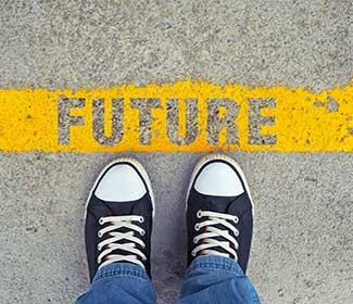 "Feet on pavement with the word ""future"" written into the yellow line."