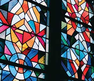 Colorful stained glass in tall church windows