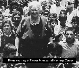 Photo of Lillian Trasher surrounded by children at her orphanage