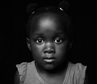 Little black girl looking directly into the camera