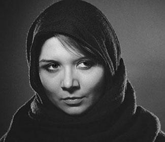Grey scale image of woman with head scarf.