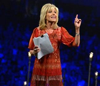Beth Moore speaking to a large crowd
