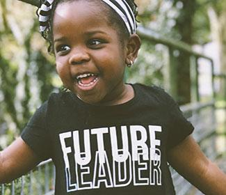 young African American child with future leader written on her shirt