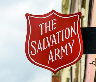 A Salvation Army sign on a building.