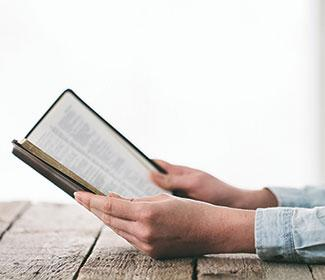 Close up of someone reading the bible.
