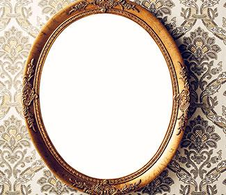 A circular mirror hanging on a wall