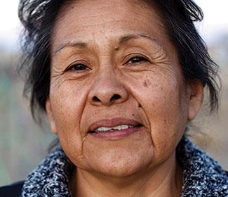Close up of a Native woman looking into the camera