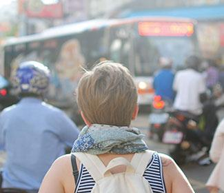 Back of a woman in a busy city