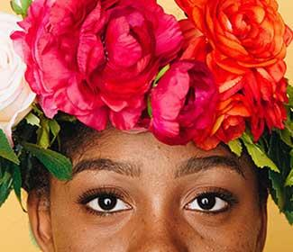 Close up of African American woman wearing floral crown