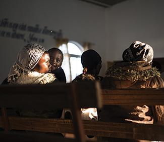 Christian woman and a child in a church in Africa