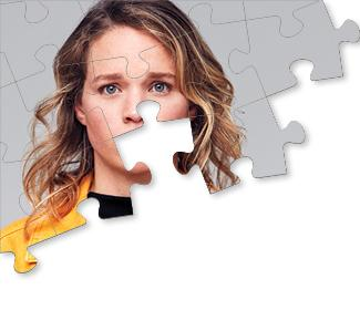 A woman's face in a puzzle,the piece with her mouth is missing