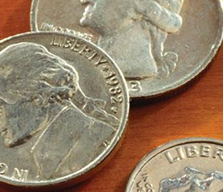 Close up photo of a dime, nickel, and quarter