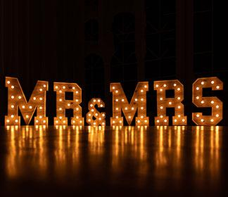 Mr. & Mrs. in lights: To Change or Not to Change: How Egalitarian Couples Navigate Last Names