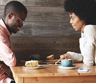 African American couple talking at a coffee shop.