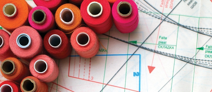 Spools of thread on a sewing pattern