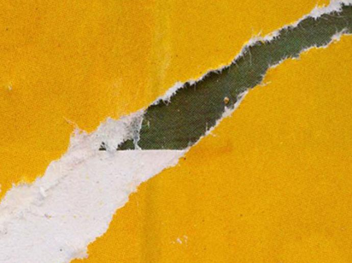 close up photo of ripped yellow wallpaper